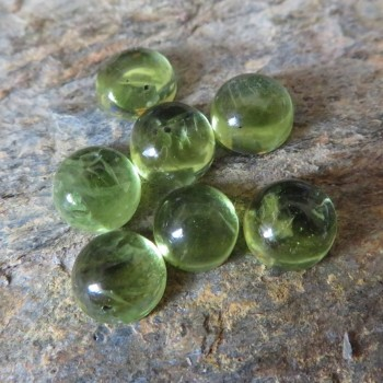 Olivine natural cabochon 5.5mm, B type; 1 piece
